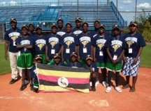 A Uganda Little League Baseball team proudly holds up their country's flag. Image: provided by the Uganda Little League Baseball organization.