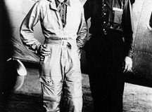 Amelia Earhart and Fred Noonan in front of the Lockheed Electra, 1937. Public domain image..