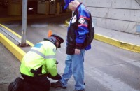 Toronto police officer Mark Borsboom lends a helping hand. Image: Jason Cassidy