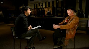 Jian Ghomeshi (left) interviews Neil Young at Toronto's Massey Hall. Image: CBC's Q with Jian Ghomeshi.