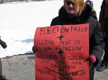 An angry citizen shares her displeasure at the Parliament buildings following the robocall scandal in 2011. Image: Wikipedia