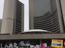 More than 60,000 people protested in Toronto, Ontario on Jan. 20. This photo was taken by TKN's Joyce Grant, outside Toronto's City Hall.