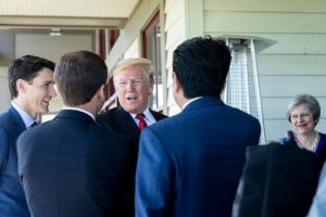 President Donald J. Trump talks with fellow leaders Canada Prime Minister Justin Trudeau, France President Emmanuel Macron, Japan Prime Minister Shinzo Abe, and Prime Minister of the United Kingdom Theresa May during their G7 Working Lunch in Canada. Image: Shealah Craighead