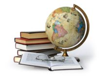 Books, globe and glasses isolated on white background with a clipping path.