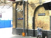 A staged Station 9 3/4 from Harry Potter, at Kings Cross Station in London