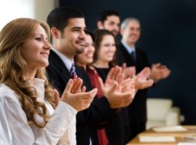Business people applauding, ie, after a presentation