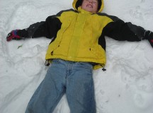 A boy making a snow angel. Image; Ren Norman