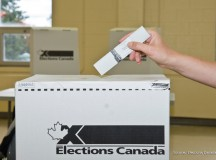 ballot going into a box