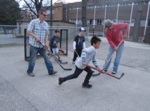 People playing ball hockey in Toronto; Image: Joyce Grant, www.teachkidsnews.com