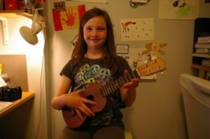 Girl playing a ukulele