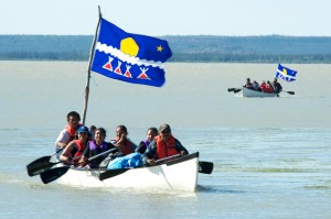 Canoes arrive in Behchoko for the annual gathering. Photo by Tessa Macintosh for the Tlicho government