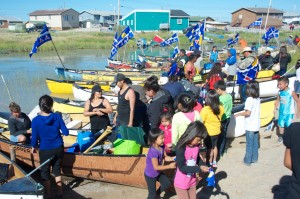 The canoes arrive at Behchoko, NWT, for the 2013 gathering. Photo by Tessa Macintosh for the Tłı̨chǫ Government.