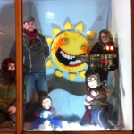 "Artists Sam Ovens, Rob Vajdec and Chantal Parent pose in their window, ""Snow Day."" Image: John Kernaghan."