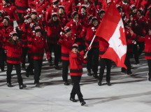 Hayley Wickenheiser, Canada's Flag bearer proudly leads Team Canada into Fisht Stadium in Sochi. Image: Mike Ridewood/ COC