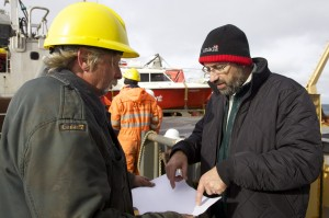 The Chief of Parks Canada's underwater archeology unit, Marc-Andre Bernier, works with Coast Guard leading seaman Keith Graham on the exploration of the  Franklin Expedition wreck.
