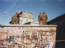 The Berlin Wall guarded by Soldiers. Image: Yann