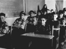 Photograph of male students from Fort Albany Residential School in class overseen by a nun c 1945. From the Edmund Metatawabin collection at the University of Algoma. Source: http://archives.algomau.ca/