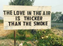 "Sign that says ""The Love int he air is thicker than the smoke"" in California. Photo by Cline Cellars winery."