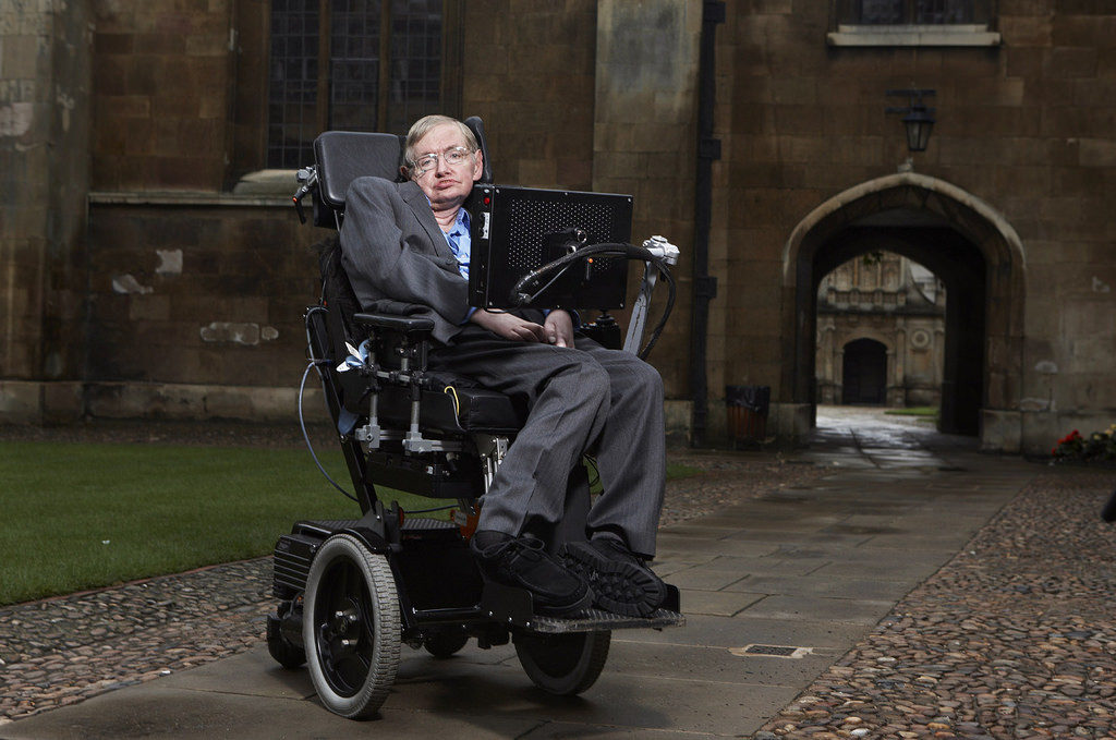 Photo of Stephen Hawking in his wheelchair. Photo by https://www.flickr.com/photos/lwpkommunikacio/