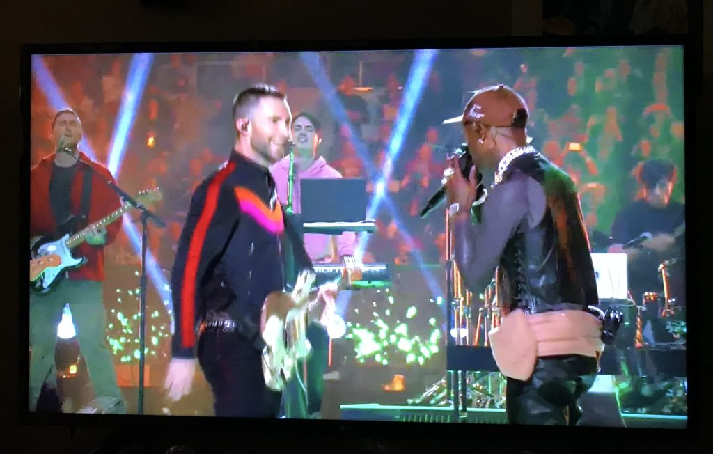 Maroon 5's Adam Levine and rapper Travis Scott perform at the 2019 Superbowl; from a CBS broadcast.